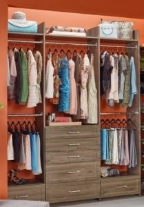 Clothes with drawers in a closet organizer