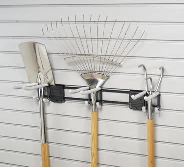 gardening tools hanging on pegboard