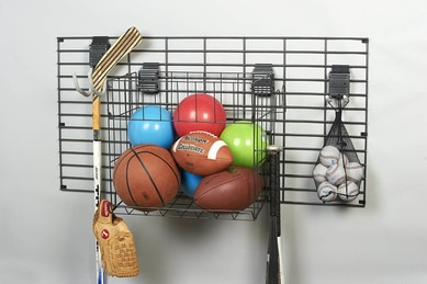 sport equipment stored on wall