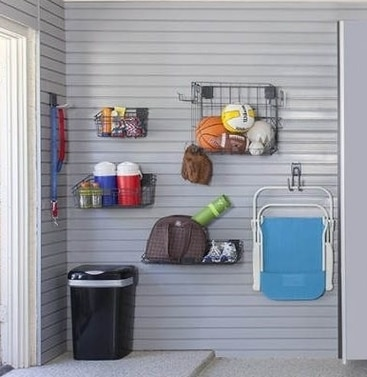 various items stored on garage wall